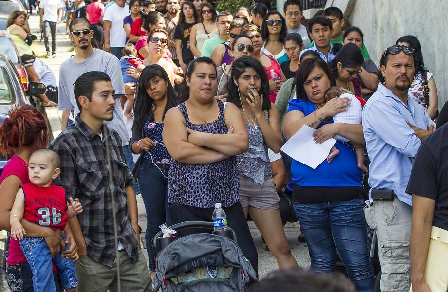 In this Aug. 15, 2012 file photo, a line of people living in the U.S. without legal permission wait outside the Coalition for Humane Immigrant Rights in Los Angeles. California is suing the Trump administration over its decision to add a question about citizenship to the 2020 U.S. Census. Photo: Damian Dovarganes, Associated Press