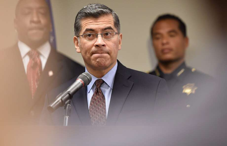California Attorney General Xavier Becerra speaks to members of the media about the investigation of the shooting death of Stephon Clark in Sacramento. Becerra said Monday he, along with other states attorneys general, will challenge a Commerce Department decision to include a citizenship question on the 2020 census taking.  Photo: Josh Edelson / AFP / Getty Images