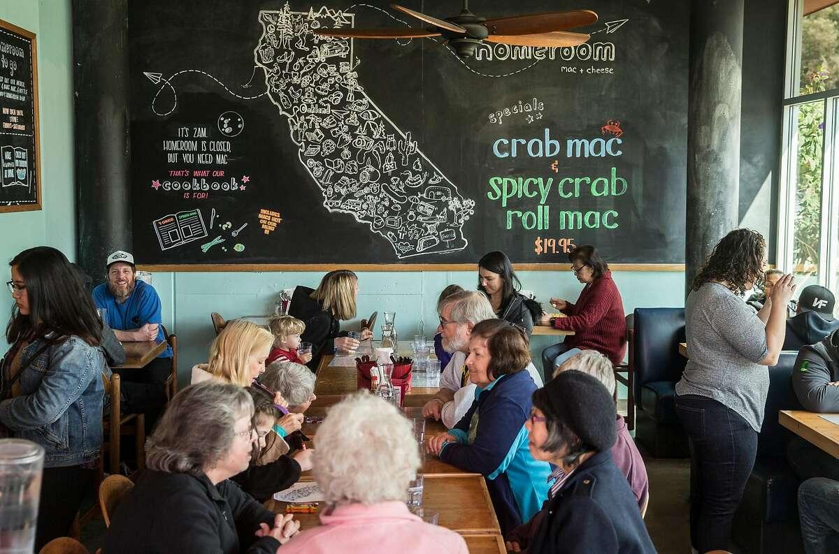 Customers fill the main dining room at Homeroom restaurant Friday, March 23, 2018 in Oakland, Calif.