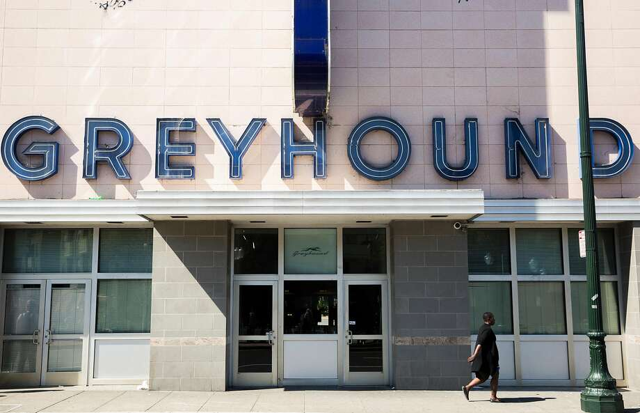 A woman walks by the main entrance of the Greyhound bus station Tuesday, March 27, 2018 in Oakland, Calif. Photo: Photos By Jessica Christian / The Chronicle