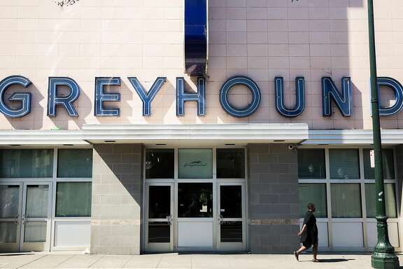 A woman walks by the main entrance of the Greyhound bus station Tuesday, March 27, 2018 in Oakland, Calif.