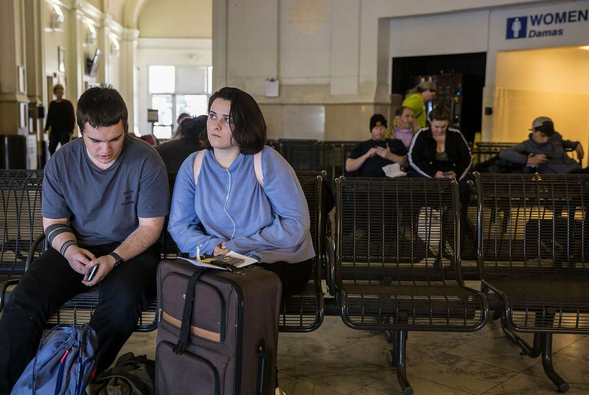 Kaamryn Bausrsfeld, 19, of Santa Barbara sits with her boyfriend after arriving at the Greyhound bus station Tuesday, March 27, 2018 in Oakland, Calif. on her way to San Francisco, Calif.