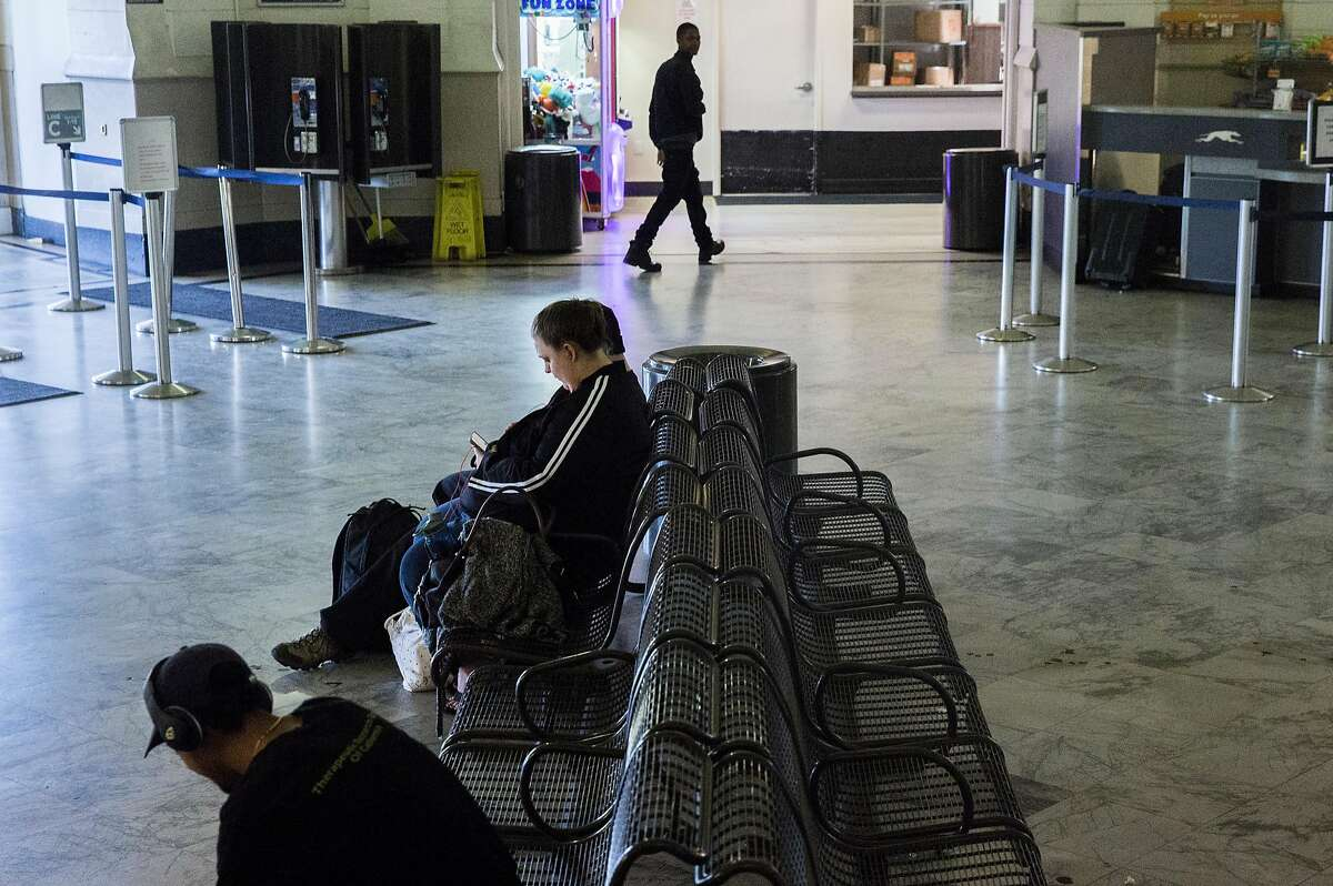 Passengers wait for a Los Angeles bound bus at the Greyhound bus station Tuesday, March 27, 2018 in Oakland, Calif.
