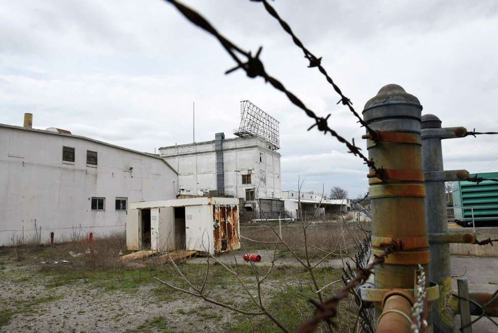 View of the former Beech-Nut plant on Wednesday, April 19, 2017, in Canajoharie, N.Y. EPA contractors were spraying the asbestos contaminated building with a protective encapsulating spray. EPA tests found unsafe levels of asbestos in piles of demolition debris and on portions of the exterior and interior of the former food plant. (Will Waldron/Times Union)