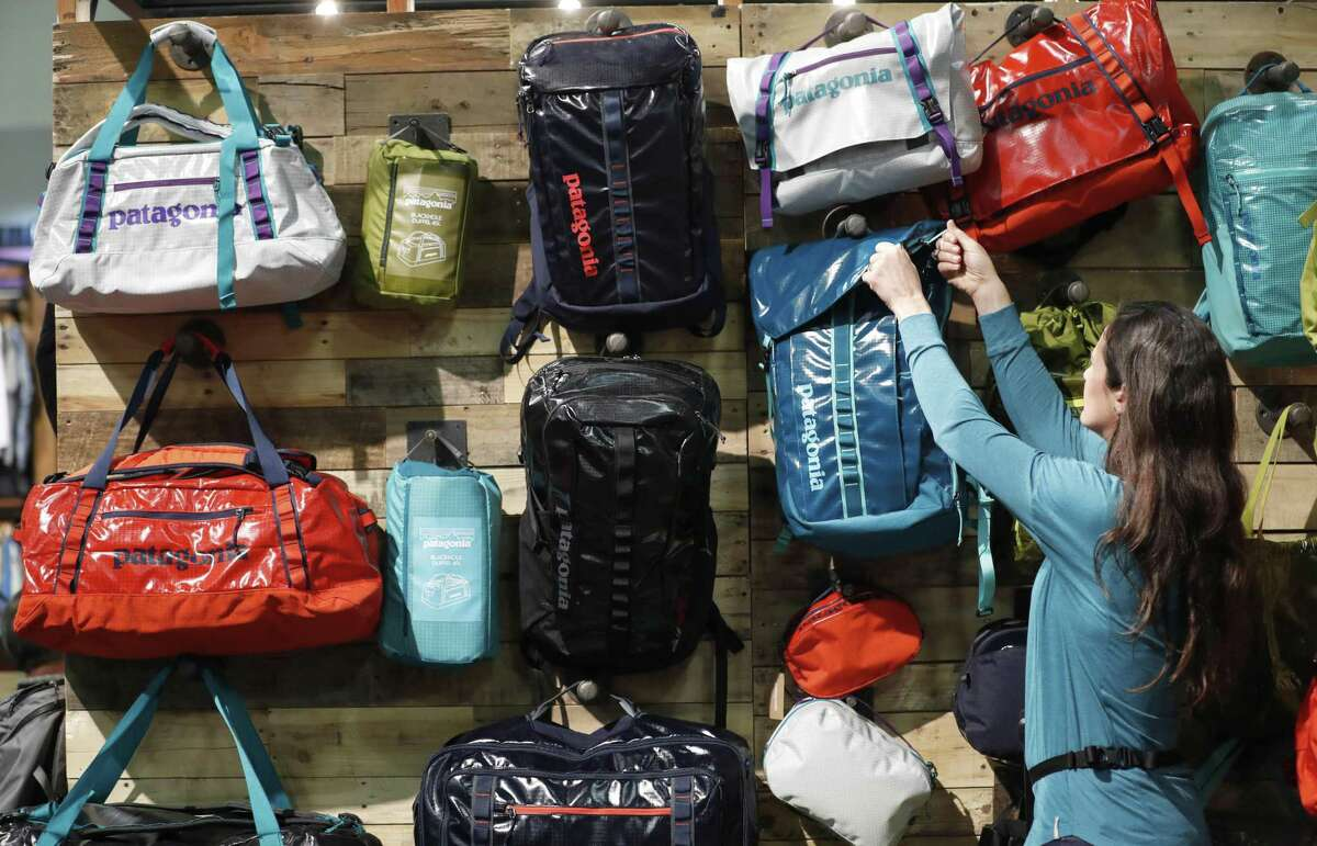 An attendee grabs a Patagonia Inc. bag at the company's booth during the 2017 Outdoor Retailers Winter Market Show in Salt Lake City, Utah, on Jan. 11, 2017. MUST CREDIT: Bloomberg photo by George Frey.