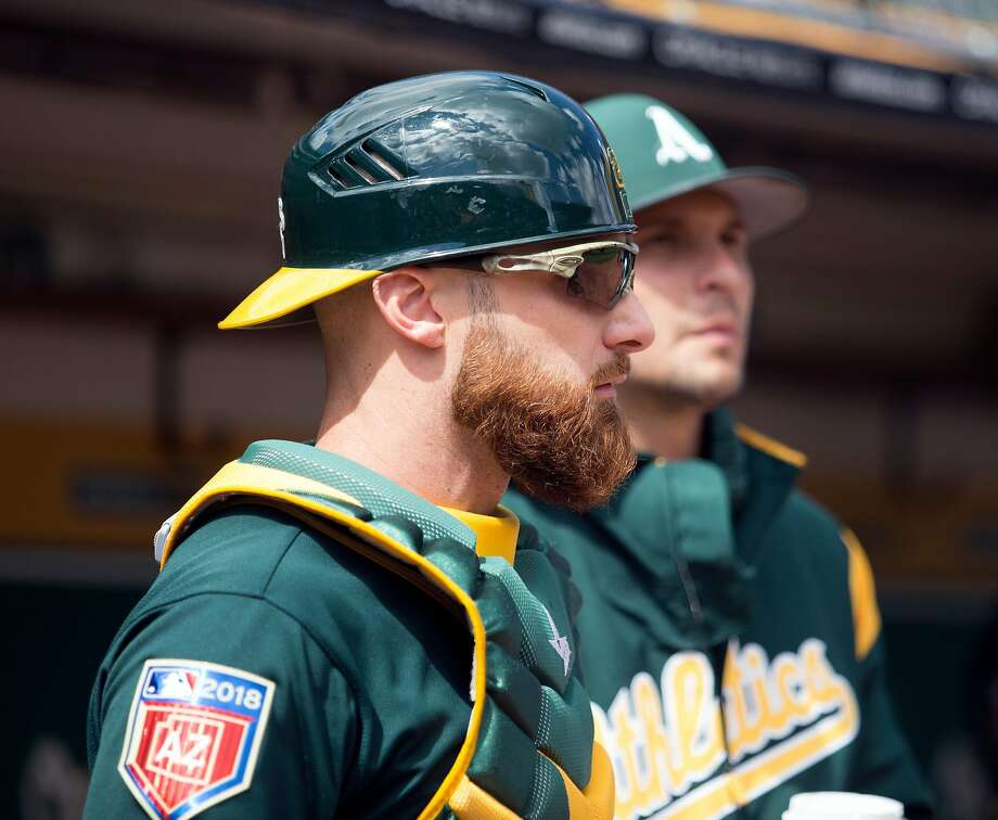 Oakland Athletics catcher Jonathan Lucroy gets ready to take the field against the San Francisco Giants before a Major League Baseball game,  Sunday, March 25, 2018 in Oakland, Calif. Photo: D. Ross Cameron / Special To The Chronicle