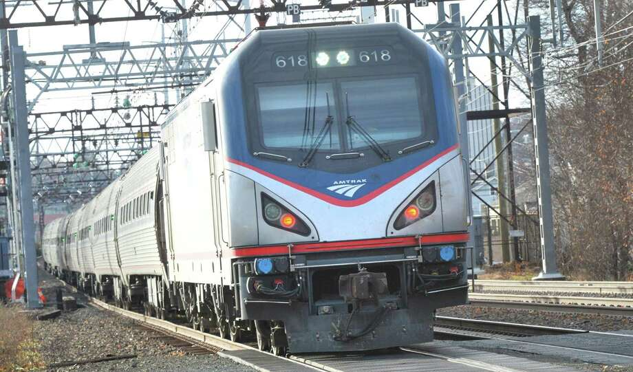 An Amtrak train passes through Norwalk eastbound on Monday December 19, 2016 in Norwalk Conn. Amtrak wants to re-route its tracks between Greenwich and Greens farms to make high speed rail travel possible Photo: Alex Von Kleydorff / Hearst Connecticut Media / Connecticut Post