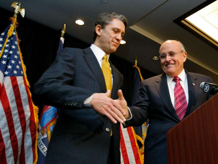 FORMER NEW York City Mayor Rudy Giuliani, right, offers his hand to Republican Rick Lazio on Tuesday after announcing he wouldn?t run for governor of New York or U.S. Senate and endorsed Lazio for governor during a news conference in New York. KATHY WILLENS/ASSOCIATED PRESS Photo: Kathy Willens / AP