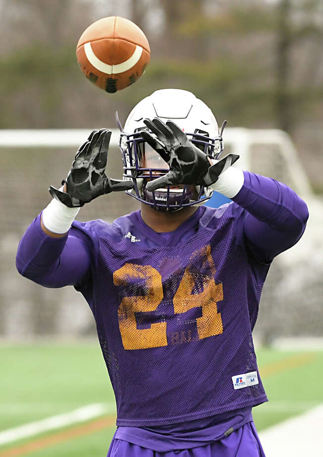 University at Albany Running back Elijah Ibitokun-Hanks catches the ball during football practice at Casey Stadium Tuesday, March 27, 2018 in Albany, N.Y. (Lori Van Buren/Times Union) Photo: Lori Van Buren / 20043314A