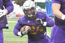 University at Albany Running back Elijah Ibitokun-Hanks runs with the ball during football practice at Casey Stadium Tuesday, March 27, 2018 in Albany, N.Y. (Lori Van Buren/Times Union)