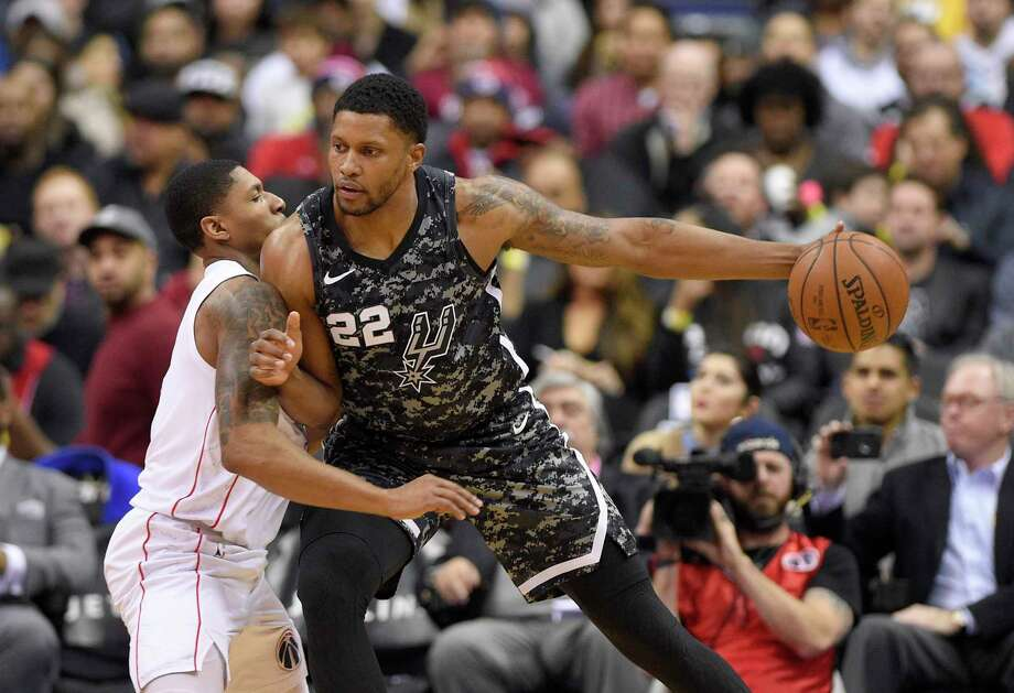 San Antonio Spurs forward Rudy Gay (22) works against Washington Wizards guard Bradley Beal during the first half of an NBA basketball game Tuesday, March 27, 2018, in Washington. (AP Photo/Nick Wass) Photo: Nick Wass, Associated Press / FR67404 AP