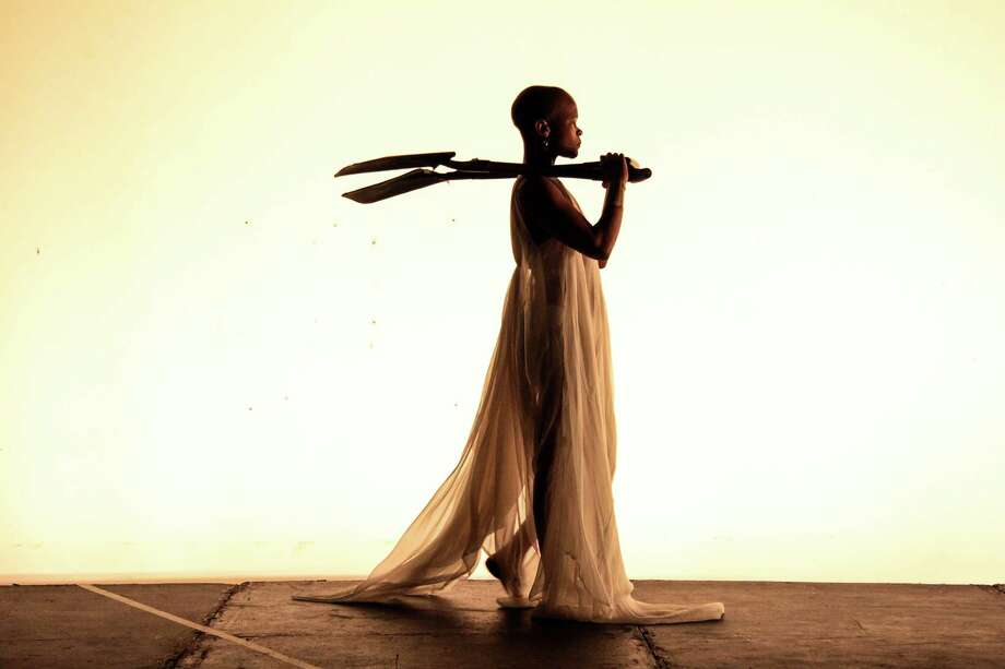 """Dada Masilo and the Dance Factory of South Africa present a contemporary version of the ballet classic, """"Giselle,"""" April 18 at the Quick Center at Fairfield University. Above Masilo, as Giselle, ominously carries two shovels. Photo: Dance Factory / Contributed Photo"""