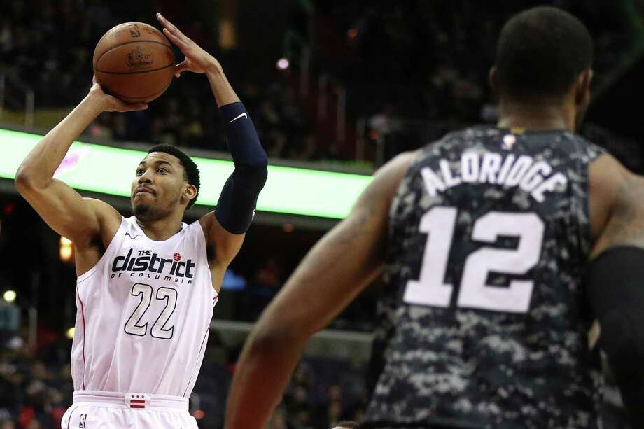 WASHINGTON, DC - MARCH 27: Otto Porter Jr. #22 of the Washington Wizards shoots in front of LaMarcus Aldridge #12 of the San Antonio Spurs during the first half at Capital One Arena on March 27, 2018 in Washington, DC. NOTE TO USER: User expressly acknowledges and agrees that, by downloading and or using this photograph, User is consenting to the terms and conditions of the Getty Images License Agreement. Photo: Getty Images / 2018 Getty Images