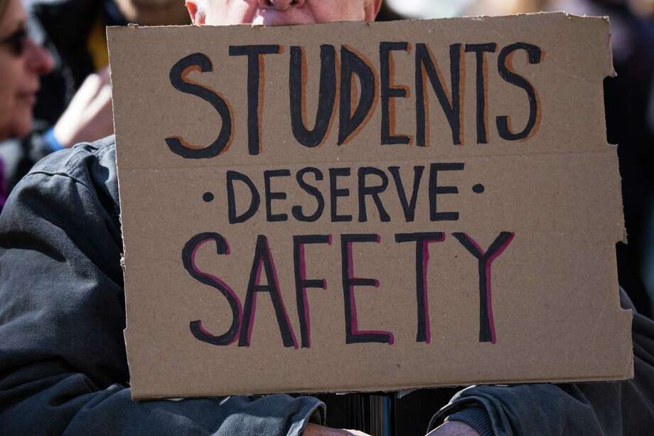 """A demonstrator holds a sign that reads """"Students Deserve Safety,"""" while gathering on Central Park West during the March For Our Lives in New York, U.S., on March 24, 2018. Thousands of high school students and other gun-control advocates gathered in Washington and across the U.S. Saturday to demand tougher firearms restrictions from an older generation that's delivered little change after years of mass shootings. Photographer: Jeenah Moon/Bloomberg Photo: Jeenah Moon / © 2018 Bloomberg Finance LP"""