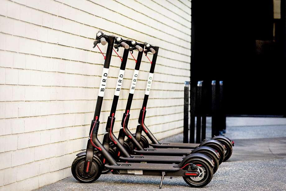 "Bird, a startup, lets people rent electric scooters with a mobile app. So-called ""dockless"" rental companies let people leave vehicles on sidewalks, a practice that is controversial in many cities. Photo: Bird"