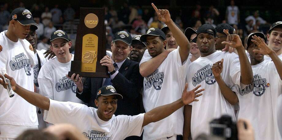 Members of the Connecticut Huskies celebrate their win over Georgia Tech 82-73 during the NCAA Final Four championship game at the Alamodome Monday, April 5, 2004. Photo: Edward A. Ornelas / San Antonio Express-News / SAN ANTONIO EXPRESS-NEWS