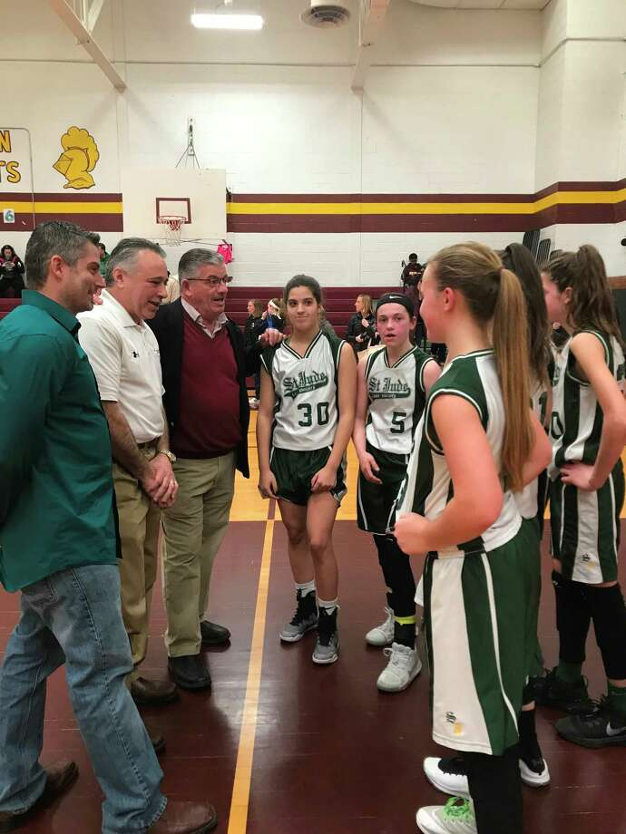 North Greenbush Supervisor Lou Desso congratulates the St. Jude?s Lady Knights following their victory in the Albany Diocese championship game at Notre Dame Bishop Gibbons High School. The seventh- and eighth-grade junior girls completed their perfect season (14-0) when they captured the area Diocese League championship on March 18 by defeating Master Christi of Albany 56-39.