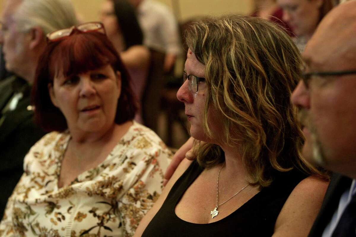 Tears stream down the face of Sherri Pomeroy, center, with her husband, pastor Frank Pomeroy, and sister, Sylvia Timmons, left, during the press conference announcing the new building plans for First Baptist Church of Sutherland Springs at the Hilton San Antonio Airport on Tuesday, March 27, 2018. Pomeroy was thinking of her friend, Karla Holcombe, who walked the grounds next to the church for years praying for God to provide the funds for the church to buy the property. Holcombe was killed at the church Nov. 5.