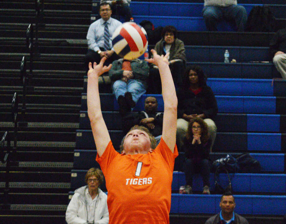 Edwardsville senior Lucas Verdun sets the ball during the second game of Tuesday's Southwestern Conference match at Belleville East.