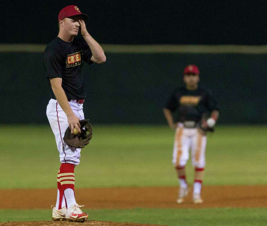Caney Creek starting pitcher Zach Greenhouse (5) reacts after giving up an RBI double during the sixth inning of a District 21-5A high school baseball game, Tuesday, March 27, 2018, in Conroe. Photo: Jason Fochtman, Staff Photographer / © 2018 Houston Chronicle