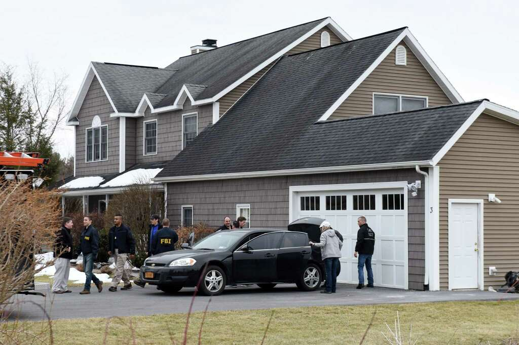 FBI and state police take computers and other evidence from the home of NXIVM co-founder Nancy Salzman which was raided by federal agents on Tuesday, March 27, 2018, in Halfmoon, N.Y. Keith Raniere, the co-founder of the NXIVM corporation has been arrested by the FBI based on a federal criminal complaint filed in the Eastern District of New York. (Will Waldron/Times Union) Photo: Will Waldron