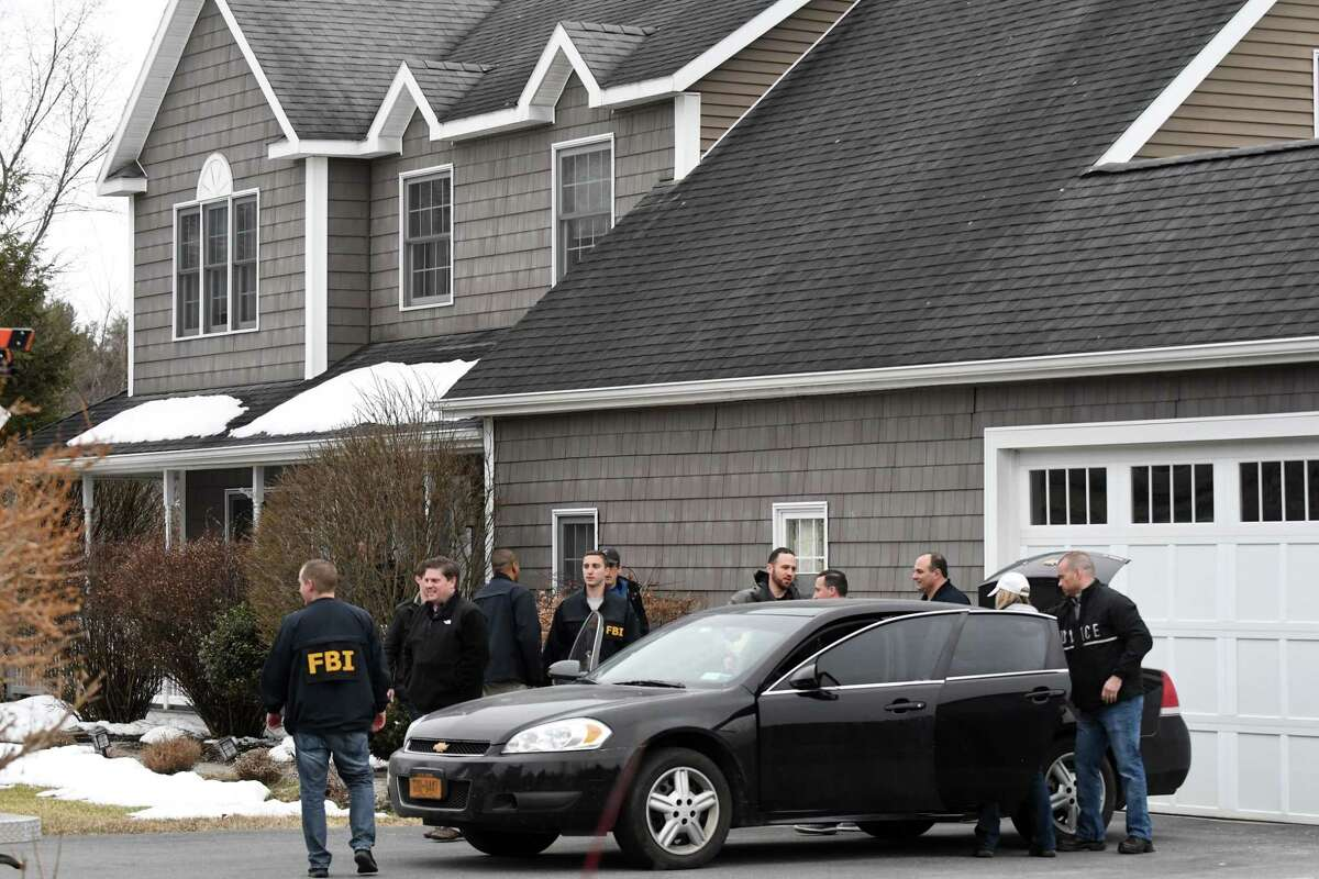 FBI and state police take computers and other evidence from the home of NXIVM co-founder Nancy Salzman which was raided by federal agents on Tuesday, March 27, 2018, in Halfmoon, N.Y. Keith Raniere, the co-founder of the NXIVM corporation has been arrested by the FBI based on a federal criminal complaint filed in the Eastern District of New York. (Will Waldron/Times Union)