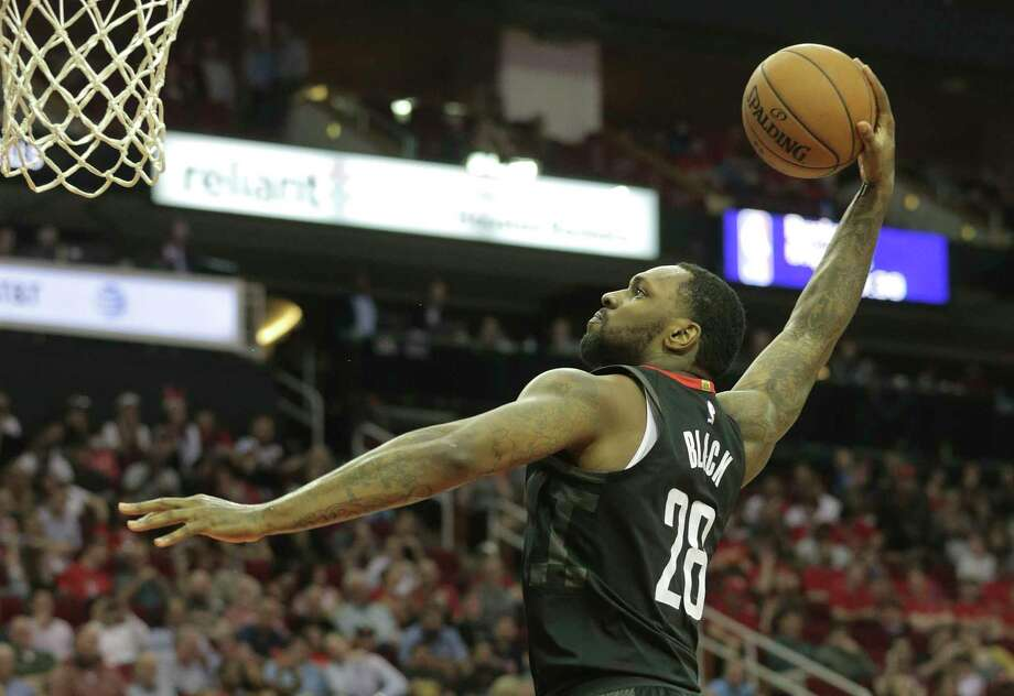 Houston Rockets forward Tarik Black (28) dunks the ball in the second half against Chicago Bulls at the Toyota Center on Tuesday, March 27, 2018, in Houston. Rockets won the game 118-86. Photo: Elizabeth Conley, Houston Chronicle / © 2018 Houston Chronicle