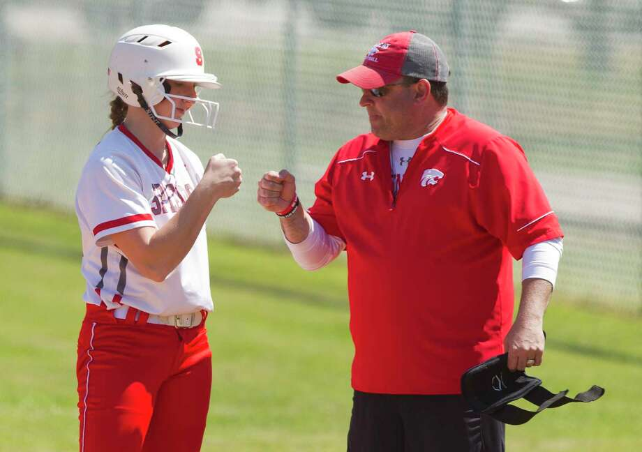 Savanna Parker #12 of Splendora gets a fist-bump after reaching first on an error by Porter starting pitcher Kailee Loving during the fifth inning of a District 21-5A high school softball game at Splendora High School, Wednesday, March 14, 2018, in Splendora. Photo: Jason Fochtman, Staff Photographer / © 2018 Houston Chronicle