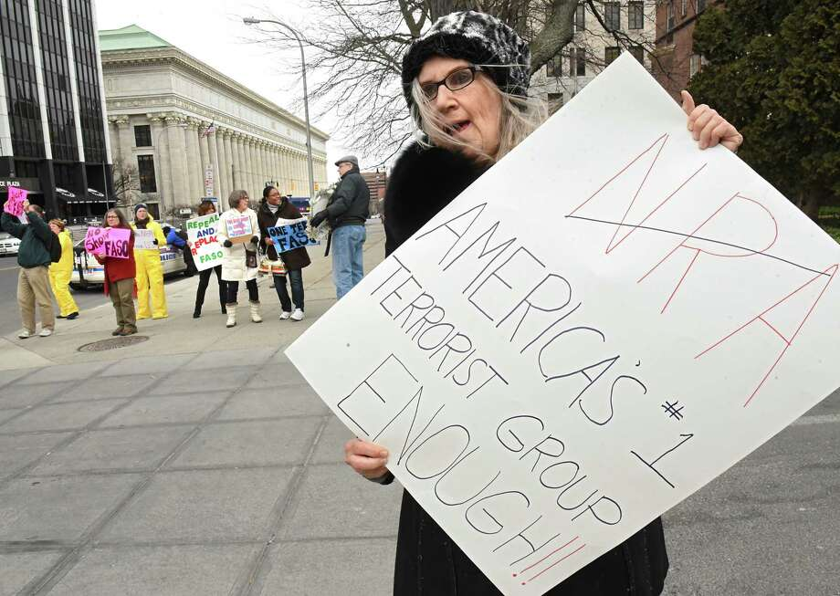Barbara Dowdell of Halfmoon stands will other protestors outside a fundraiser for John Faso and Elise Stefanik at the Fort Orange Club on Tuesday, March 27, 2018 in Albany, N.Y. (Lori Van Buren/Times Union) Photo: Lori Van Buren / 20043308A