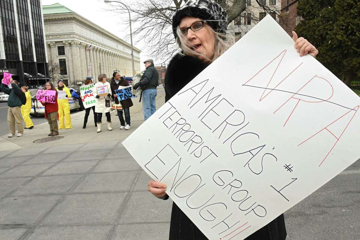 Barbara Dowdell of Halfmoon stands will other protestors outside a fundraiser for John Faso and Elise Stefanik at the Fort Orange Club on Tuesday, March 27, 2018 in Albany, N.Y. (Lori Van Buren/Times Union)