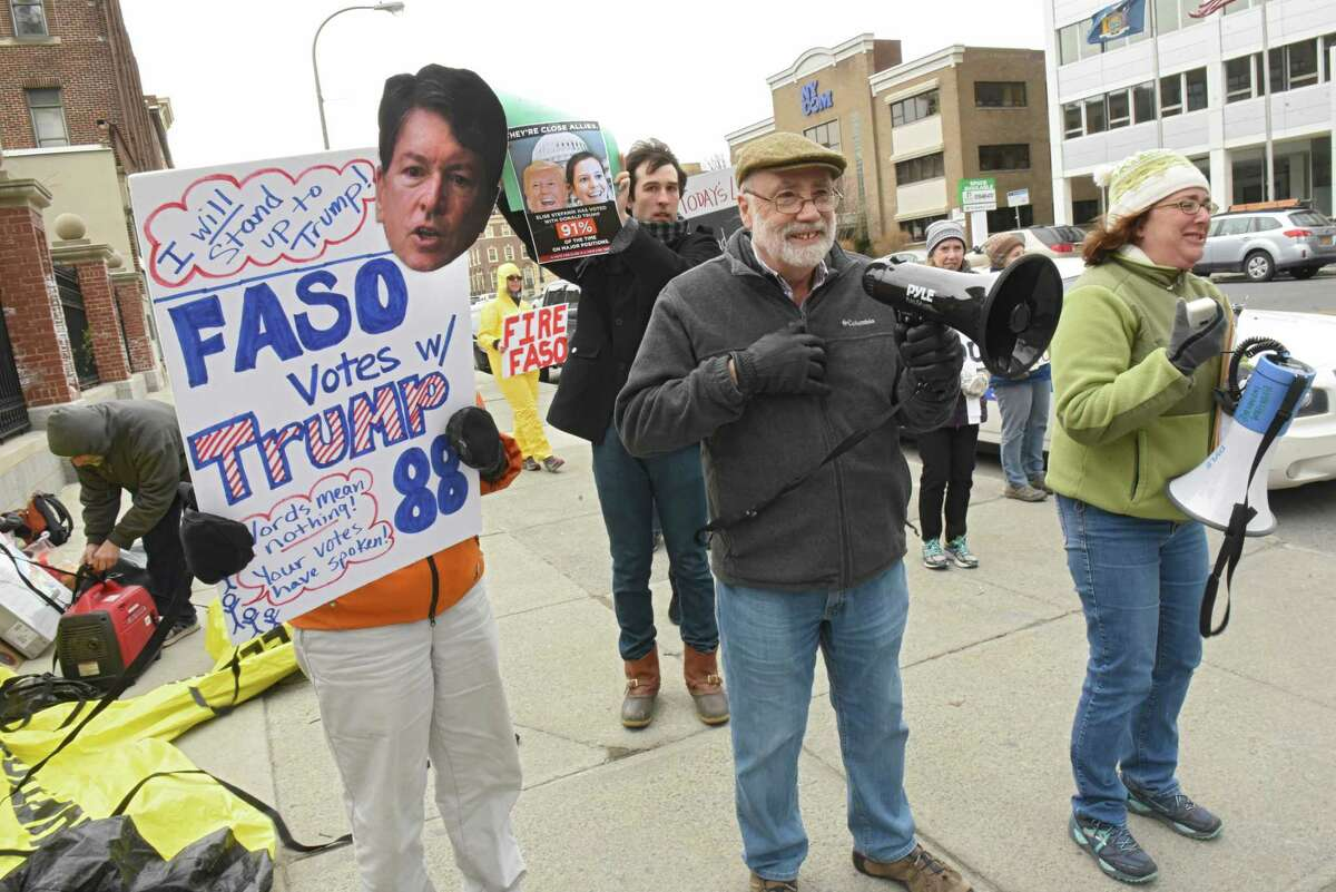 People show up to protest a fundraiser for John Faso and Elise Stefanik at the Fort Orange Club on Tuesday, March 27, 2018 in Albany, N.Y. (Lori Van Buren/Times Union)