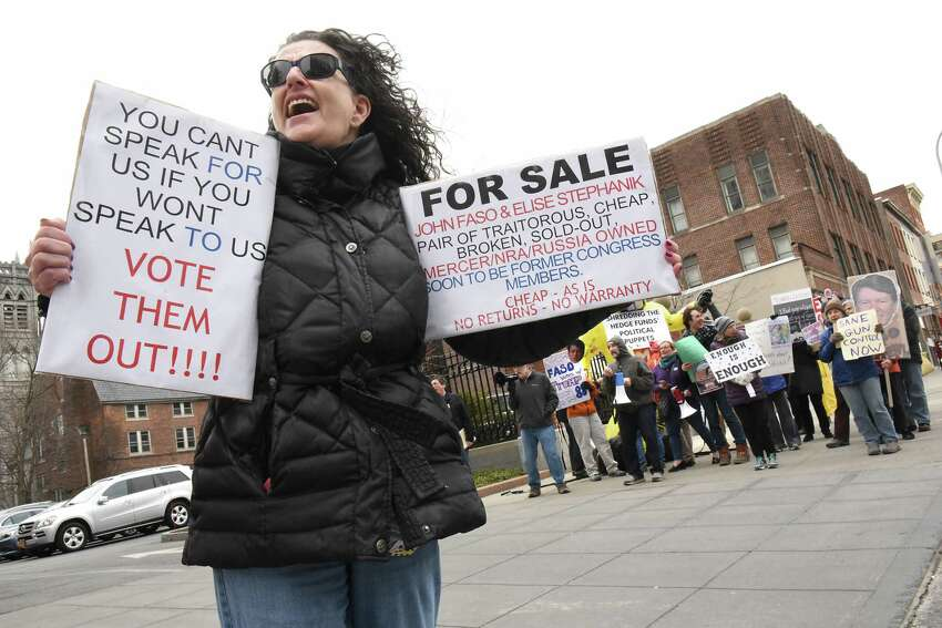 Nancy Eckert of Ravena, left, stands will other protestors outside a fundraiser for John Faso and Elise Stefanik at the Fort Orange Club on Tuesday, March 27, 2018 in Albany, N.Y. (Lori Van Buren/Times Union)