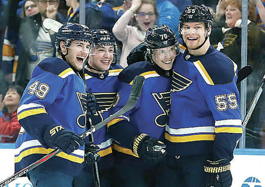 The Blues' Oskar Sundqvist (70) is congratulated by teammates Ivan Barbashev (49), Vince Dunn and Colton Parayko (55) after scoring in the first period against the San Jose Sharks Tuesday night in St. Louis. Photo: AP