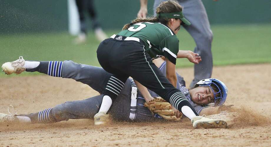 Mac base runner Sara Montes is safe as she beats the tag by the Rattler's Tina Ayalaat second as Reagan beats MacArthur 6-4 at North East ISD Softball Fields on March 27, 2018. Photo: Tom Reel, Staff / San Antonio Express-News / 2017 415916Z.1 ANTONIO EXPRESS-NEWS
