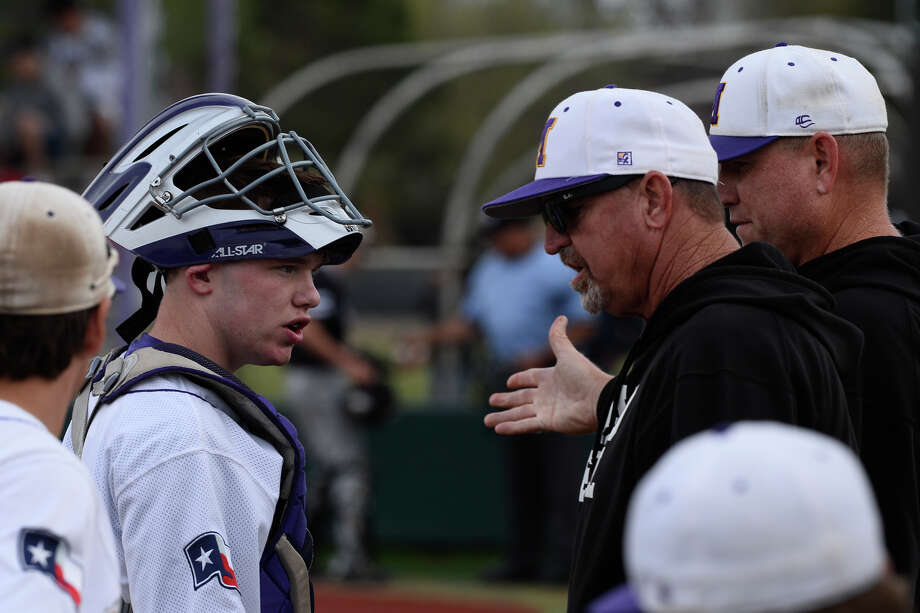 Midland High baseball head coach Barry Russell and assistant coach Danny Neighbors have a word with catcher Wyatt Taylor during the game against Permian March 27, 2018, at Zachery Field.  James Durbin/Reporter-Telegram Photo: James Durbin