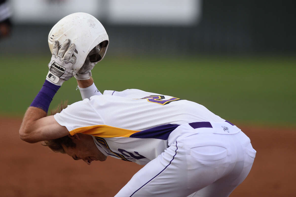 Midland High's Tyler Wade (2) expresses frustration after his hit was caught for an out to finish the inning against Permian March 27, 2018, at Zachery Field. James Durbin/Reporter-Telegram