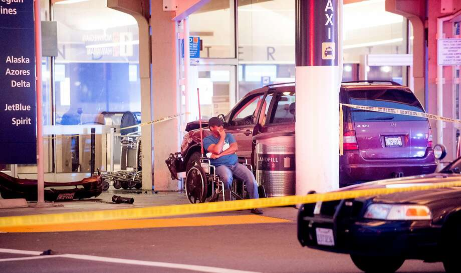 A man sits in a wheelchair at the scene of a car accident at Oakland International Airport's Terminal 1 on Tuesday, March 27, 2018, in Oakland, Calif. Photo: Noah Berger, Special To The Chronicle