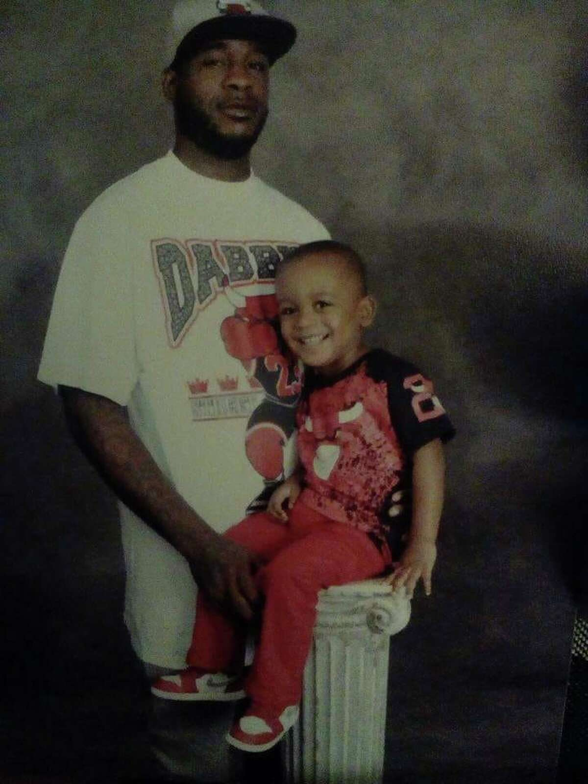 A photo of Danny Ray Thomas, 34, and his son, Damari Ray Thomas. Danny Ray Thomas was shot and killed by a Harris County sheriff's deputy on March 22. An investigation by the sheriff's office and the Houston Police Department into the shooting is ongoing.