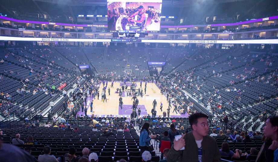 The Kings and Mavericks warm up in an almost empty arena as doors were closed for a second time amid protests outside. Photo: Hector Amezcua / TNS
