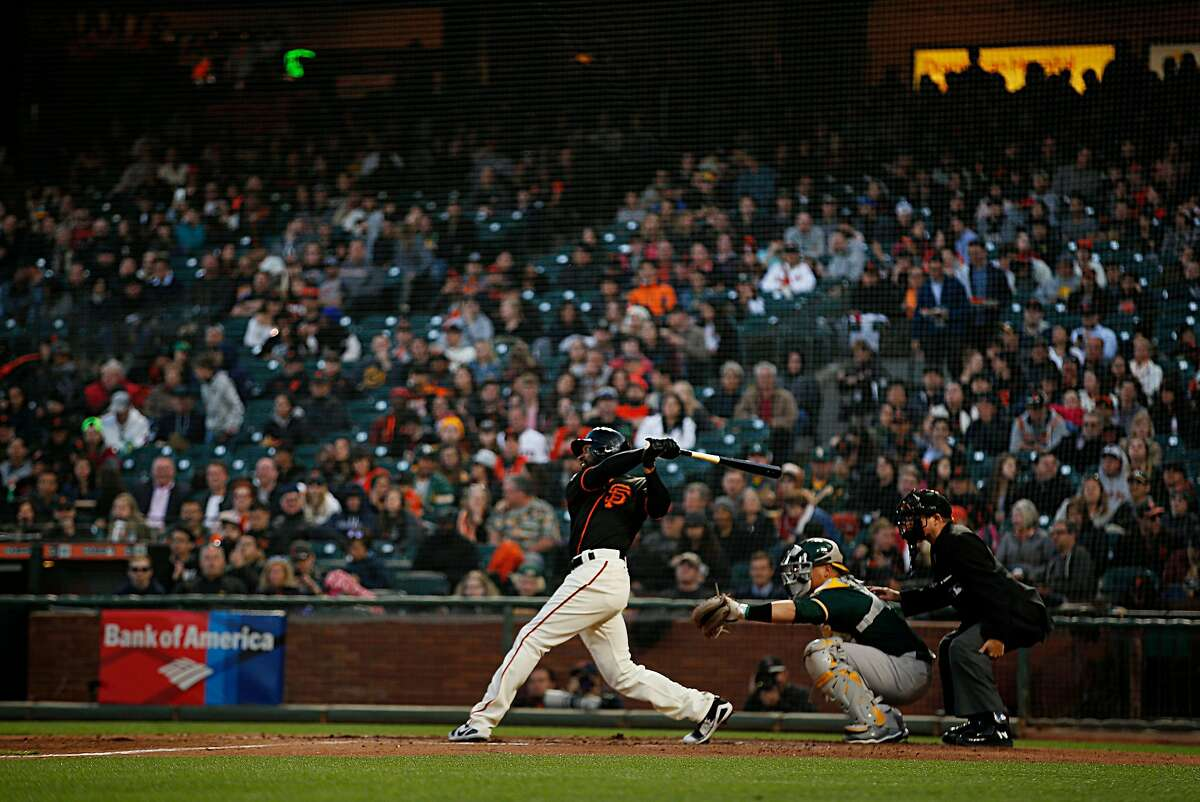 San Francisco Giants center fielder Austin Jackson (16) makes contact and brings in two scoring runners during a Spring Training MLB game between the San Francisco Giants and Oakland Athletics at AT&T Park, Tuesday, March 27, 2018, in San Francisco, Calif.