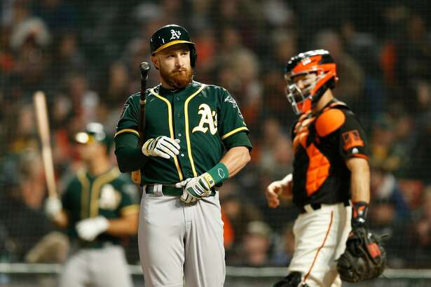 Oakland Athletics catcher Jonathan Lucroy (21) at bat during a Spring Training MLB game between the San Francisco Giants and Oakland Athletics at AT&T Park, Tuesday, March 27, 2018, in San Francisco, Calif.