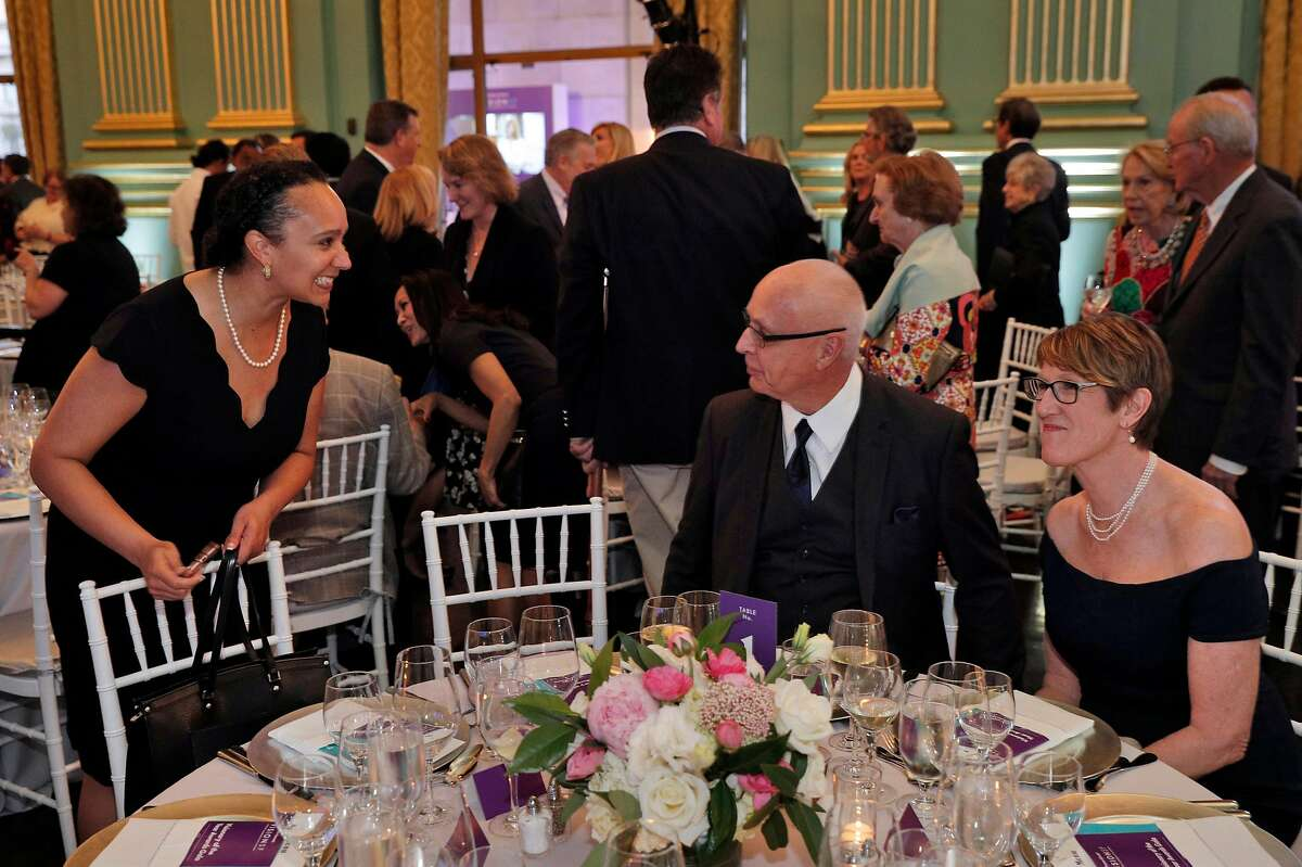 Naomi Kelly, left, talks with David Willson, center, and Naomi Fuchs, nominee for Visionary of the Year, during the San Francisco Chronicle VisionSF Visionary of the Year Award at the War Memorial Veterans Building in San Francisco, Calif., on Tuesday, March 27, 2018.