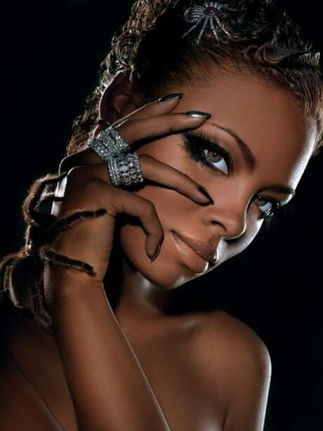America's Next Top Model Cycle 3 winner Eva The Diva and a furry friend. Photo: VH1