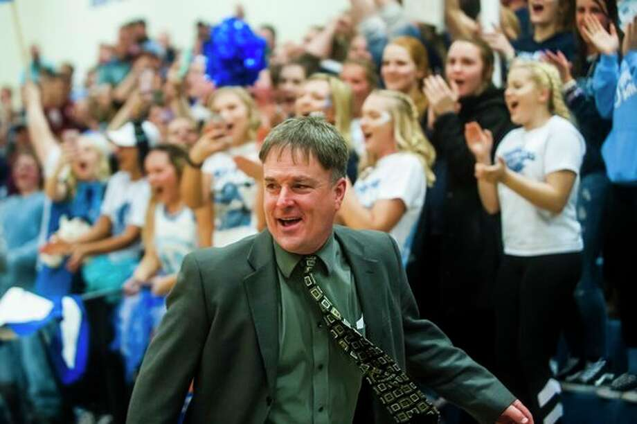 Meridian boys' basketball coach Mitch Bohn celebrates with fans in the student section after his team's regional final win over Mason County Central two weeks ago. (Katy Kildee/kkildee@mdn.net)