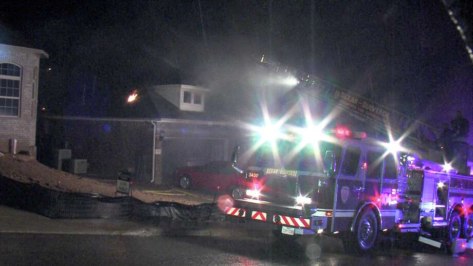 The lightning struck the house in the 2500 block of Cielo Trace around 2 a.m. When firefighters with the Bexar County Fire Department arrived, heavy flames were pouring from the roof. Photo: Ken Branca