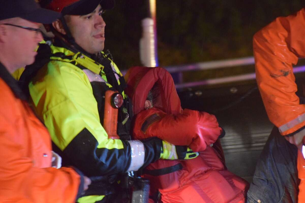 Firefighters saved two people Wednesday morning from rushing flood waters in a creek on the Northeast Side.