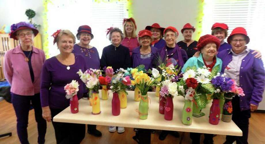 "The Red Hat ladies, known as the ""Sexy Senoritasâ€� from the Port Hope area, recently visited the residents at the Lakeview Extended Care and Rehab in Harbor Beach Community Hospital. With Easter being Sunday and spring is in the air, the ladies made vases with flowers for each resident to have in their rooms. They played a guitar and sang songs and the residents sang along to the Easter and spring songs. (Submitted photo)"