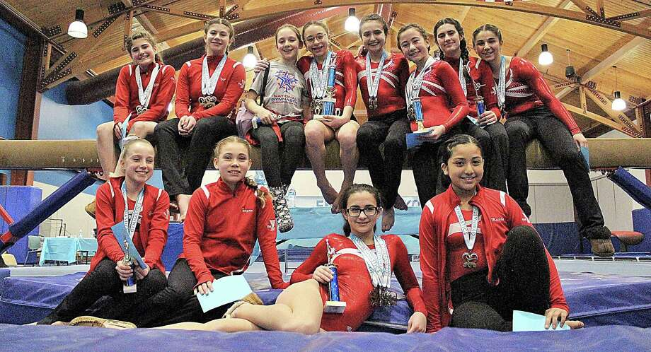 The Wilton Y Gymnastics team had a successful run at an invitational meet in Darien. Some of the Level 4 gymnasts competing include: front row, from left, Ella Mancuso, Teagan Stengrim, Sofia Vitti, and Madeline Mosquera, and back row, from left, Elizabeth Fahey, Isabella Silverstein, Cailyn Cruickshank, Jeni Von Bartheld, Emma Incao, Ella Arghirescu, Simona Gheorghe, and Nina Ferrucci. Photo: Contributed Photo/Hearst Media Connecticut