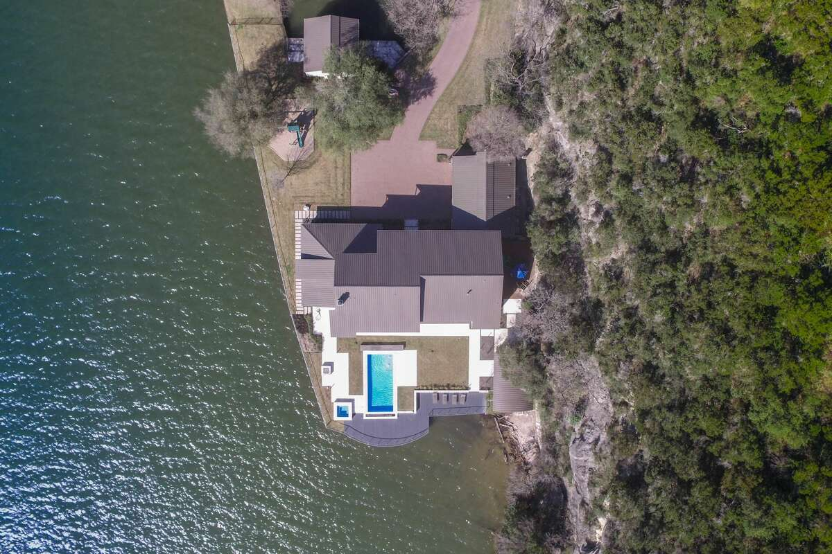 DCIM\100MEDIA\DJI_0307.JPG 3901 Watersedge off of Lake Austin has broken records of being the highest-ever price tag for an Austin MLS residential listing after being sold for $12.3 million. Past record-breakers were ranches with acreage starting at 128 acres.