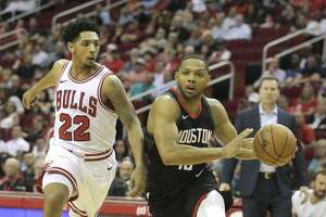 Houston Rockets guard Eric Gordon (10) drives to the basket past Chicago Bulls guard Cameron Payne (22)  at the Toyota Center on Tuesday, March 27, 2018, in Houston. ( Elizabeth Conley / Houston Chronicle )